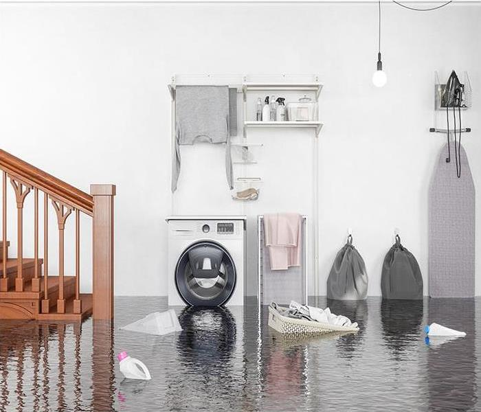 Water damaged laundry room with debris floating